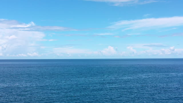 aerial flying over caribbean water looking out to sea over the horizon, daytime - french overseas territory stock videos & royalty-free footage