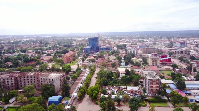 aerial flying over center of lubumbashi city, congo, in africa - saint paul stock-videos und b-roll-filmmaterial