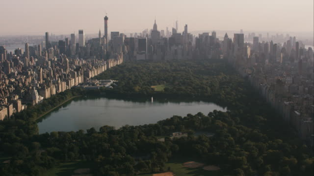 Aerial flying over Central Park looking south at park and midtown Manhattan