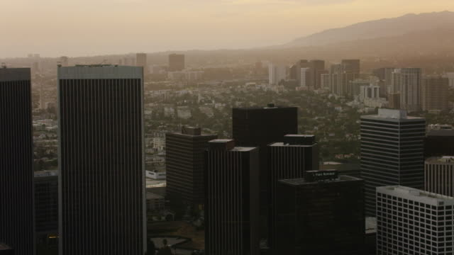 aerial flying over century city in los angeles, ca sunset - century city stock videos & royalty-free footage