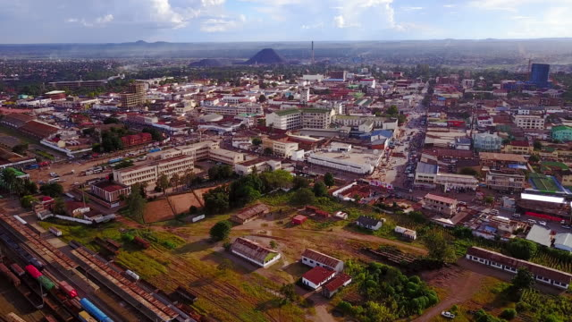 aerial flying over city of lubumbashi, congo, in africa - democratic republic of the congo stock videos & royalty-free footage