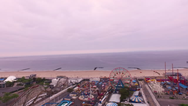 aerial flying over coney island, beach and ocean in brooklyn, new york city - coney island stock videos & royalty-free footage