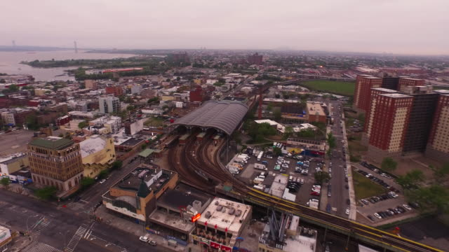 aerial flying over coney island subway out over beach in brooklyn, new york city - coney island stock videos & royalty-free footage