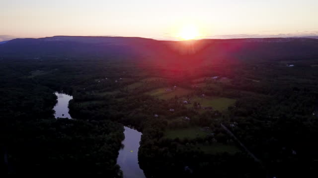 aerial flying over countryside with river at sunset - new paltz stock videos and b-roll footage