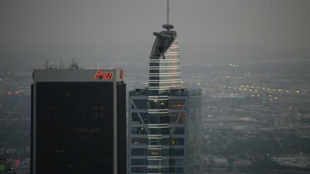 vídeos de stock e filmes b-roll de aerial flying over downtown los angeles ca, sunset - aproximar imagem