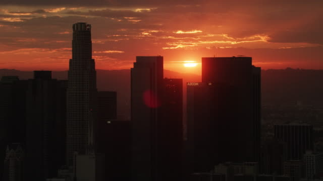 Aerial flying over Downtown Los Angeles, CA sunset