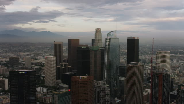 aerial flying over downtown los angeles, ca sunset - wide stock videos and b-roll footage