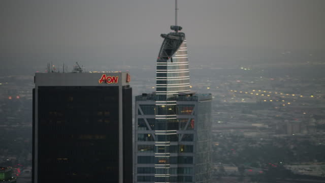 Aerial flying over downtown Los Angeles CA, sunset
