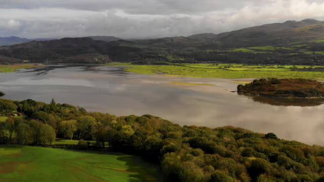 aerial flying over estuary at high tide in north wales, daytime - estuary stock videos & royalty-free footage