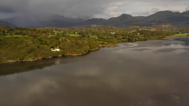 aerial flying over estuary at high tide in north wales, daytime - wales stock-videos und b-roll-filmmaterial