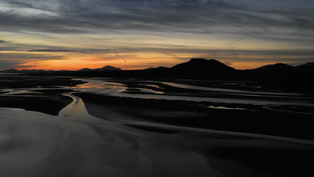 aerial flying over estuary at low tide in north wales, sunset - tide stock videos & royalty-free footage