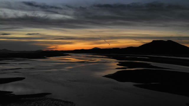 aerial flying over estuary at low tide in north wales, sunset - beach stock videos & royalty-free footage