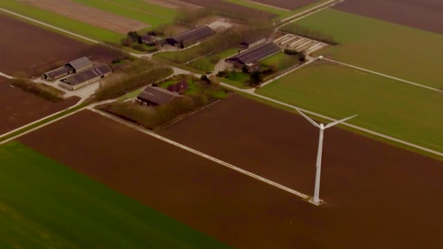 aerial flying over farmland in the netherlands - 北ホラント州点の映像素材/bロール