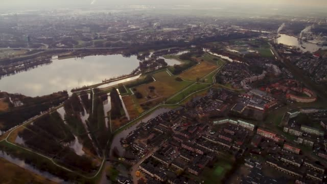aerial flying over field of land and water north of amsterdam, netherlands daytime - 北ホラント州点の映像素材/bロール