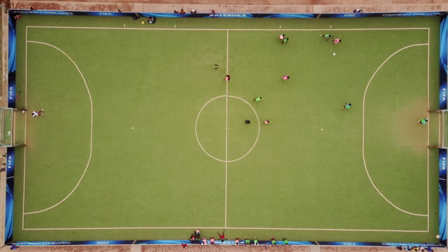 Aerial flying over football field, in Congo Africa daytime
