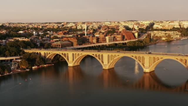stockvideo's en b-roll-footage met aerial flying over francis scott key bridge and potomac river, dc - potomac rivier