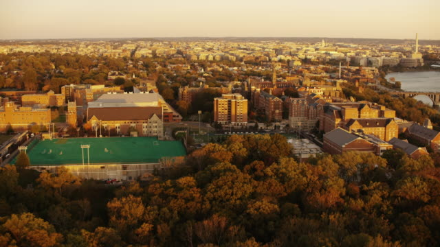 Aerial flying over Georgetown University, Washington D.C. sunset