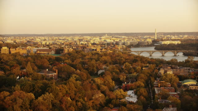 Aerial flying over Georgetown University, Washington D.C. sunset