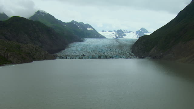 aerial flying over glacier in alaska - extreme terrain stock videos & royalty-free footage