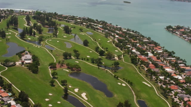 aerial flying over golf course, miami fl  - green golf course stock videos and b-roll footage
