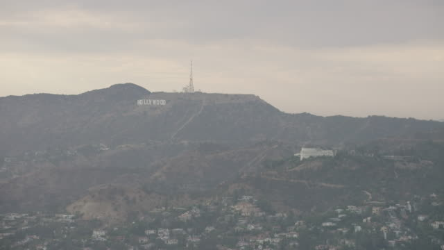 aerial flying over griffith park looking at hollywood sign la, ca late afternoon - griffith observatory stock videos & royalty-free footage