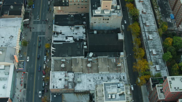 aerial flying over harlem looking directly down on streets in nyc - harlem stock videos & royalty-free footage