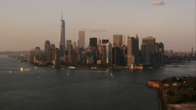 Aerial flying over Hudson and East river towards lower Manhattan at the end of the day, NYC
