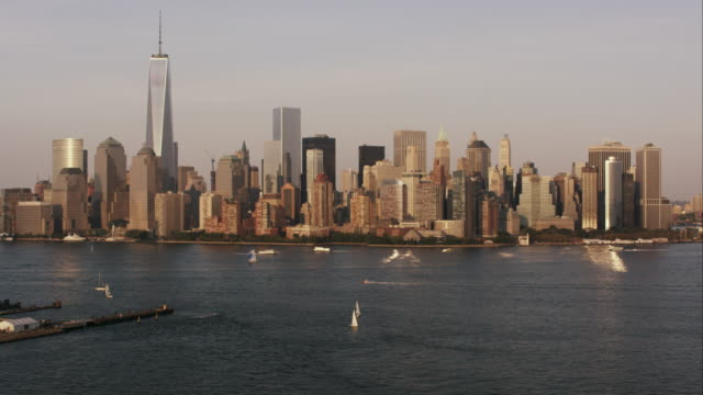 Aerial flying over Hudson River with view of lower Manhattan, NYC