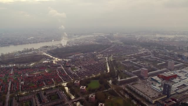 aerial flying over industrial area of amsterdam, netherlands daytime - 北ホラント州点の映像素材/bロール