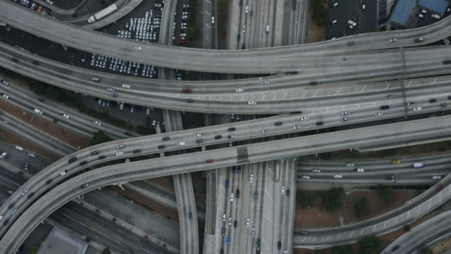 aerial flying over interchange in los angeles, ca morning - バイパス点の映像素材/bロール