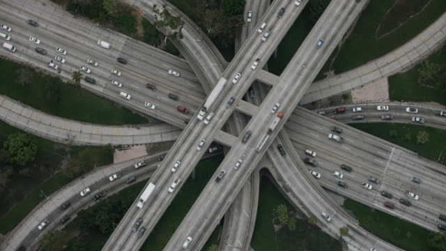 aerial flying over interchange in los angeles, ca morning - motorway junction stock videos & royalty-free footage