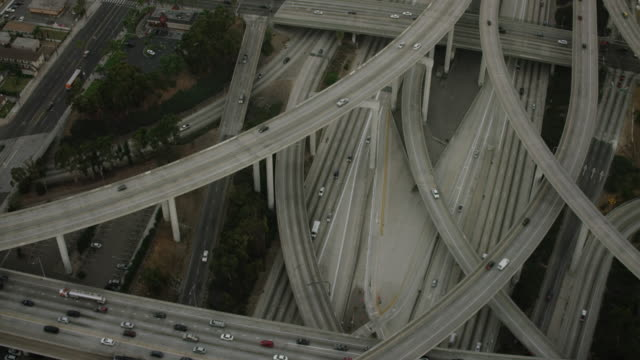 aerial flying over interchange in los angeles, ca morning - highway stock videos & royalty-free footage