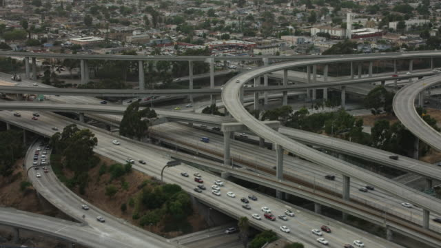 aerial flying over interchange in los angeles, ca - interstate 10 stock videos & royalty-free footage