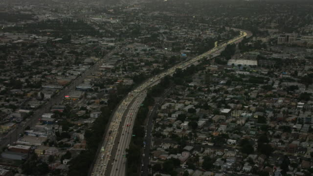 aerial flying over interstate 10 in los angeles ca, rush hour - interstate 10 stock videos & royalty-free footage