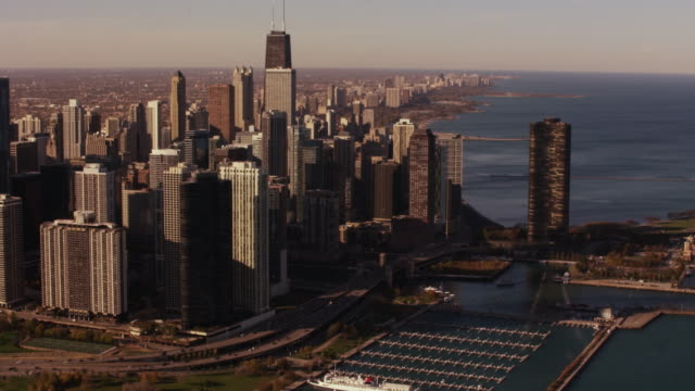 aerial flying over lake michigan looking at chicago skyline - two prudential plaza stock videos & royalty-free footage
