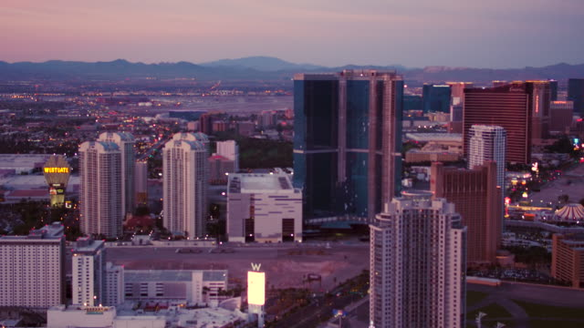 Aerial flying over Las Vegas view of Hotels and Casinos, Sunset