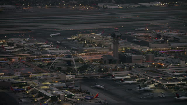 aerial flying over lax airport, los angeles, ca - air traffic control tower stock videos & royalty-free footage