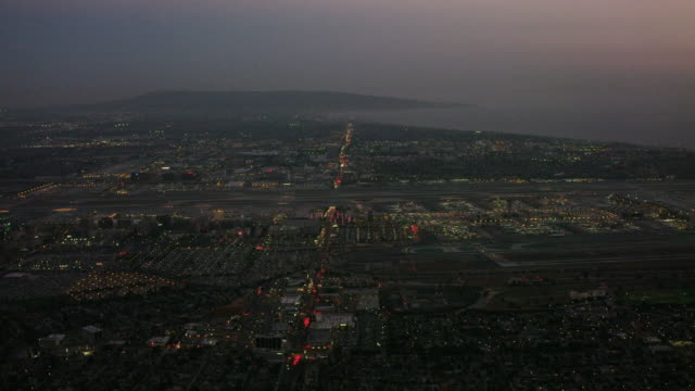 aerial flying over lax airport, los angeles, ca - lax airport stock videos & royalty-free footage