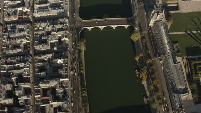 aerial flying over looking directly down on la seine river in paris france, daytime - river seine stock videos & royalty-free footage