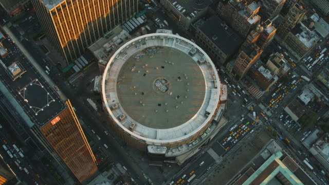 Aerial flying over Madison Square Garden (MSG) and Midtown Manhattan at the end of the day