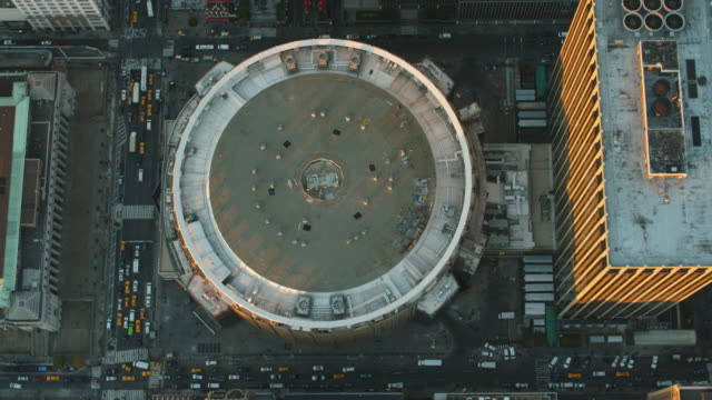 Aerial flying over Madison Square Garden (MSG) in Midtown Manhattan at the end of the day