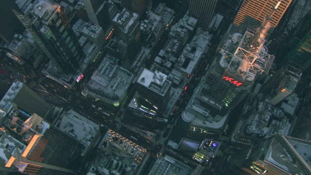 aerial flying over midtown manhattan looking down at central park covered in snow nyc - upper west side manhattan stock videos and b-roll footage