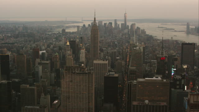aerial flying over midtown manhattan looking south over buildings at sunset in nyc - 2014 stock videos and b-roll footage