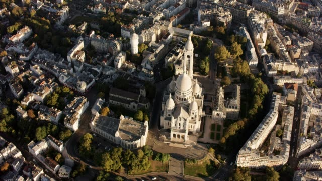 aerial flying over montmartre and the sacré-cœur in paris france, morning - basilique du sacre coeur montmartre stock videos & royalty-free footage
