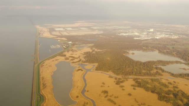 Aerial flying over nature north east of Amsterdam, Netherlands daytime