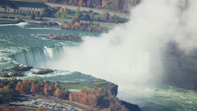 aerial flying over niagara falls and niagara river, daytime  - niagara falls stock videos and b-roll footage