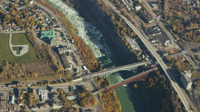 vídeos de stock, filmes e b-roll de aerial flying over niagara river, canadian border new york, daytime - niagara falls