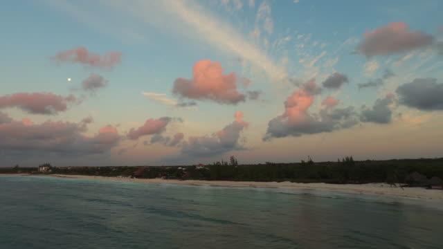vídeos y material grabado en eventos de stock de aerial flying over ocean towards beach and coastline - playa del carmen