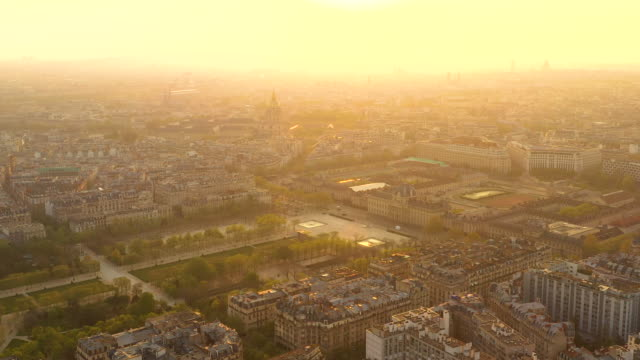 aerial flying over paris at sunrise, view looking at sun rising over the city - offiziersschule école militaire stock-videos und b-roll-filmmaterial