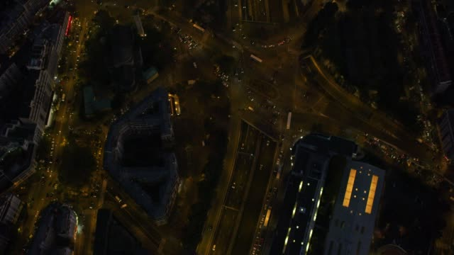 aerial flying over paris france at night looking directly down on traffic, streets, and lights - paris france stock videos & royalty-free footage